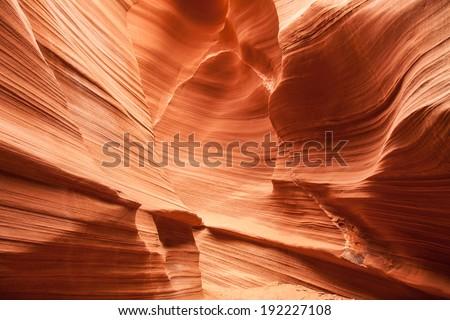 Interior of Antelope Canyon, woderful orange waves made of stone - stock photo