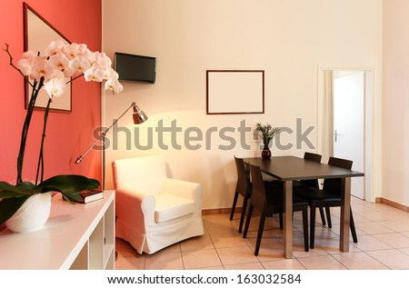 interior of apartment, living room with dining table - stock photo