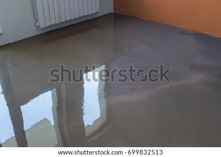 Interior Of Apartment Under Construction. Floor Covering With Self Leveling  Cement Mortar. Mirror Smooth