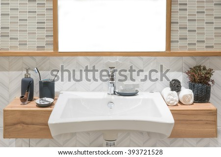 Interior of bathroom with washbasin faucet and white towel.Modern design of bathroom. - stock photo