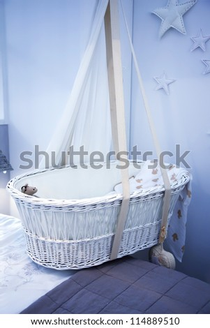 interior of bed room with child basket - stock photo