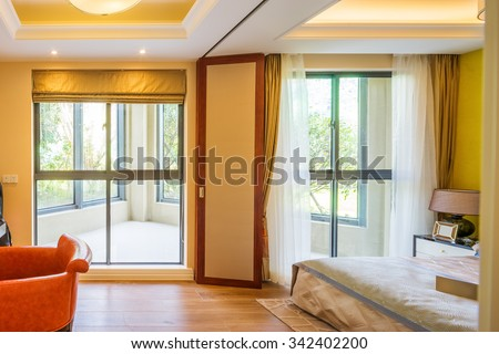 interior of bedroom with balcony in modern villa