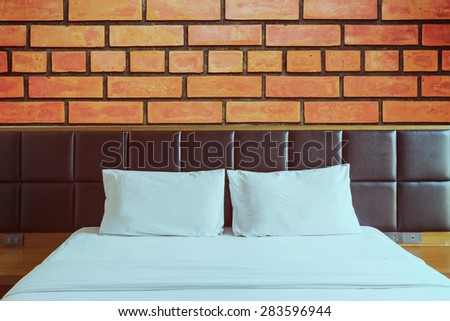 Interior of bedroom with brick block wall background - stock photo