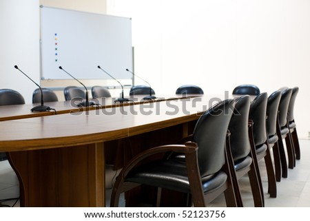Interior of board room with conference table and comfortable chairs