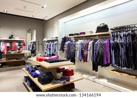 interior of brand new fashion clothes store - stock photo