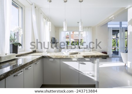 Interior of bright kitchen in new house - stock photo