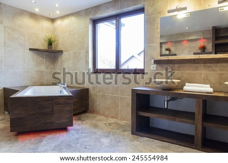 Interior of brown bathroom in modern house - stock photo