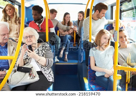 Interior Of Bus With Passengers - stock photo