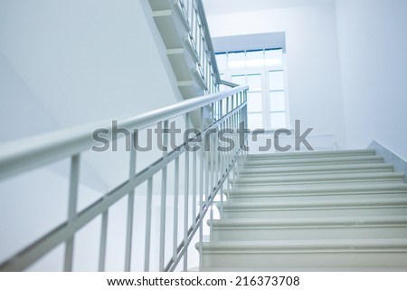 Interior of business center office building made with doors white ladders marble elevators elevators loft and hall - stock photo
