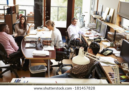 Interior Of Busy Architect's Office With Staff Working - stock photo