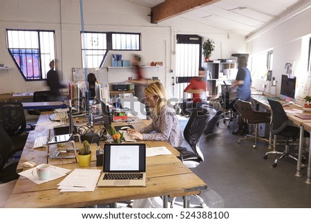 Interior Of Busy Design Office With Staff