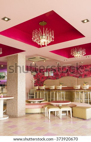 interior of cafe in bright colors modern soft focus fasoni cafe in