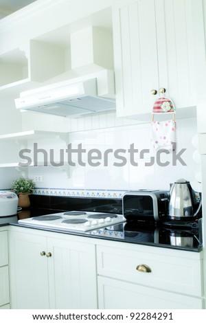 Interior  of clean modern white and black kitchen - stock photo