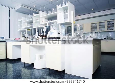 Interior of clean modern white medical or chemical laboratory background. Laboratory concept without people. Horizontal template for a poster, webpage or leaflet.
