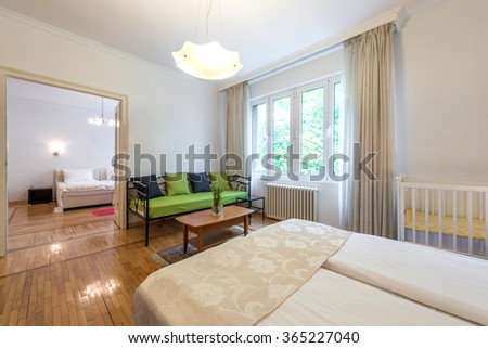 Interior of comfortable hostel room - stock photo
