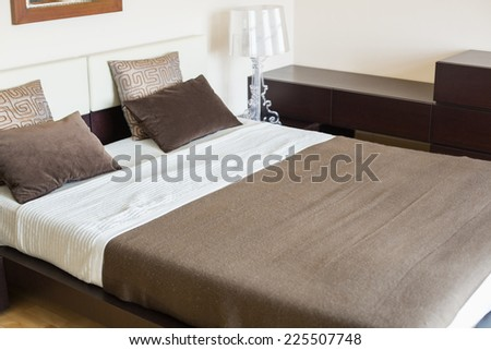 Interior of contemporary bedroom - stock photo