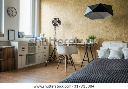 Interior of contemporary studio for young person - stock photo