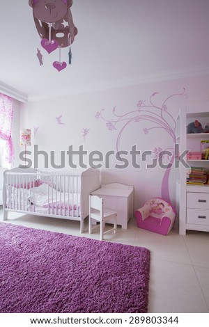Interior of cute room for baby girl - stock photo