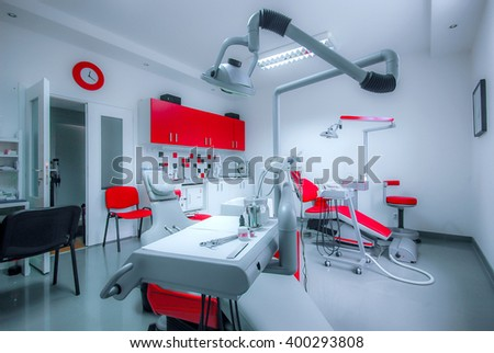Interior of dental clinic with dental chair, dental tools and dental lighting equipment, BLUE TONE