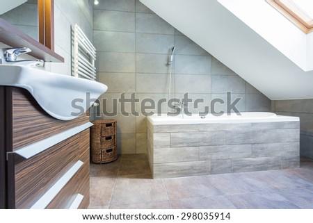 Interior of designer bathroom in luxury house - stock photo
