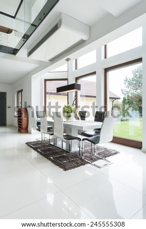 Interior of dining area in designed house - stock photo