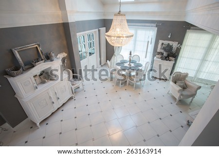 Interior of dining room inside expensive residence - stock photo