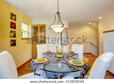 Interior Of Dining Room With Yellow Contrast Wall And Hardwood Floor Elegant Chairs Nicely