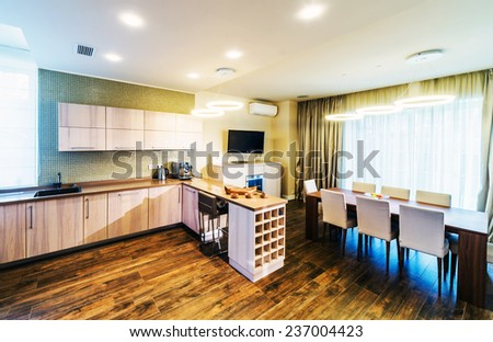 interior of dinning room with cuisine part of luxury apartment