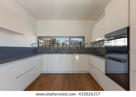 Interior of empty apartment, wide domestic kitchen