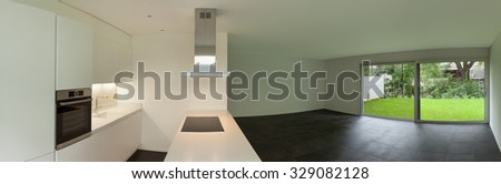 interior of empty apartment, wide living room with kitchen