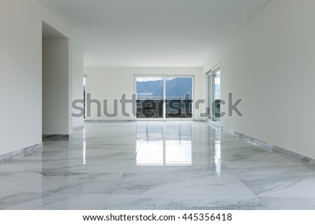 Interior of empty apartment, wide room with marble floor - stock photo