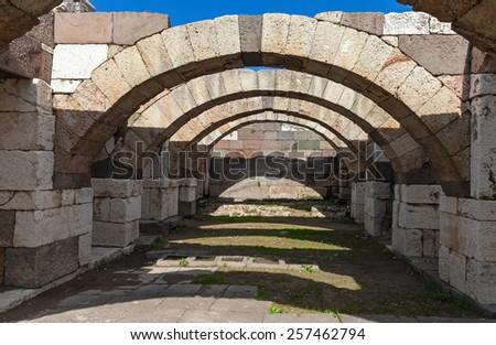 Interior of empty corridor with arcs. Ruins of Ancient city Smyrna. Izmir, Turkey - stock photo