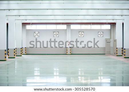 Interior of empty hall in factory with industrial fan regurator - stock photo