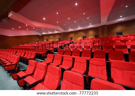 Interior of empty hall with red arm-chairs - stock photo