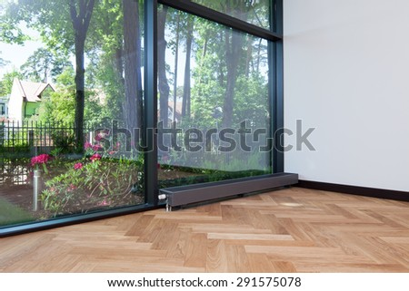 Interior of empty room with a view - stock photo