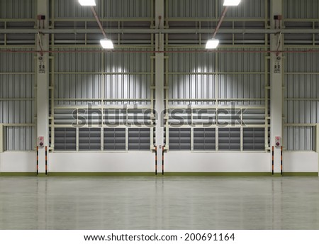 Interior of factory, night time. - stock photo