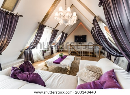 Interior of fashionable living room in the attic  - stock photo