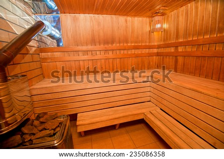Interior of Finnish wooden sauna - stock photo