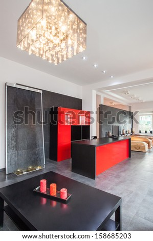 Interior of funeral office with red and black colours