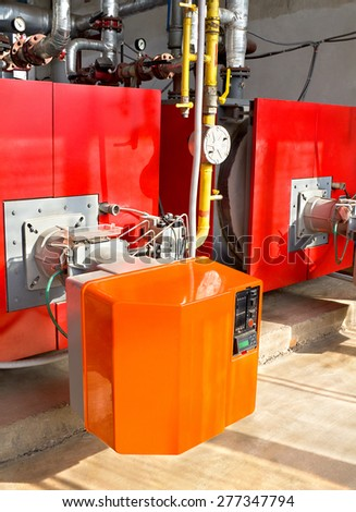 Interior of  gas boiler-house with two boilers - stock photo