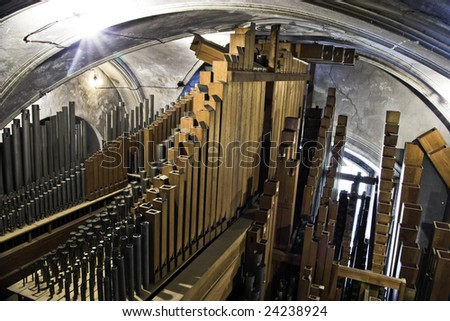 Interior of giant pipe organ - stock photo