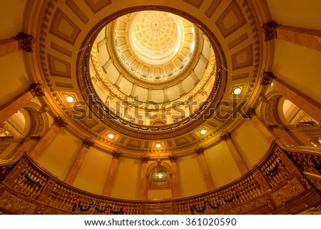 Interior of Gold Dome - A low-angle view of interior Gold Dome, and its stair cases with holiday decorations, in Colorado State Capitol Building, Denver, Colorado, USA. - stock photo