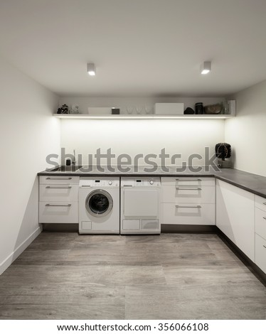 Interior of house, laundry with wooden floor - stock photo