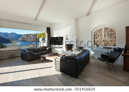 Interior of house, modern comfortable living room with wide window - stock photo