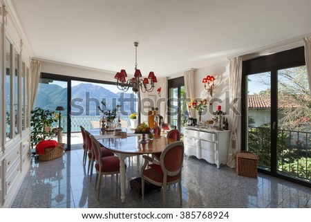 Interior of house, table and chairs of a dining room, classic decor - stock photo