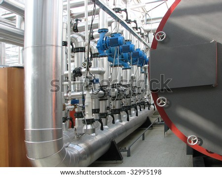 Interior of independent boiler average capacity. Pump group - stock photo