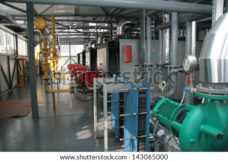 Interior of independent modern gas boiler-house with two steel boilers - stock photo