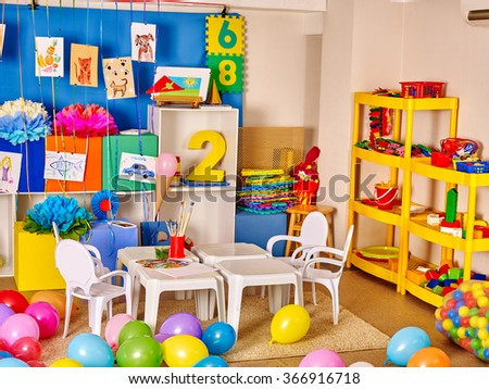 Interior of kids game room with toys in kindergarten. - stock photo