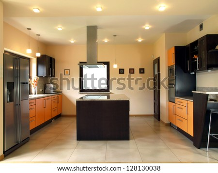 Interior of kitchen in a modern house - stock photo