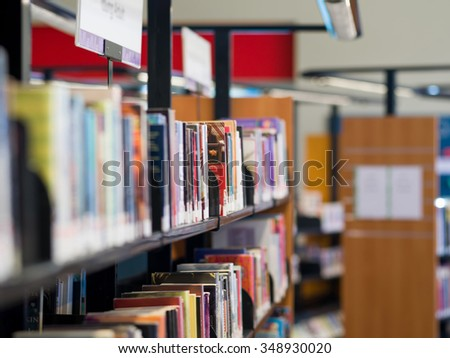 Interior of library with book shelves with books - stock photo